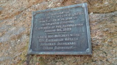 This plaque is affixed to a huge boulder that rests in a wooded area a few hundred yards away from the Setauket village green.
