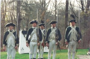 Reenactors dressed in the documented green and white uniforms worn by DeLancey's Brigade.